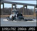 -tug-duty-towing-empty-coal-barge-3-07e.jpg